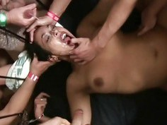 Handcuffed slut gets gangbanged