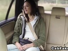 Slim teen sucks big cock in fake taxi