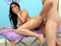 Sophia Leone leaned on the massage table and got pussy fucked