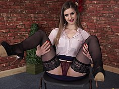 Young babe in stockings flashing upskirt