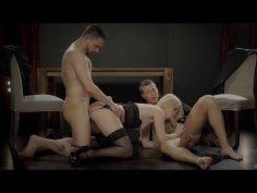 Cutie in black lingerie double teamed by two hung studs
